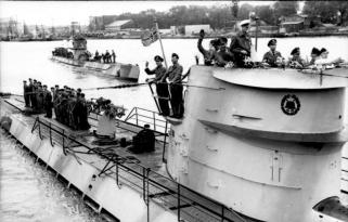 Adalbert Schnee (white cap) on the conning tower of U-201 as it leaves Lorient on 8 June 1941 for its 2nd war patrol.