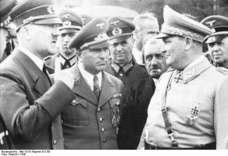 Hitler meeting Reich Commissioner Robert Ley, automotive engineer Ferdinand Porsche and Reichsminister Hermann Göring at the Wolfschanze in 1942.