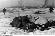 German soldiers tend to a wounded comrade near Moscow, November–December 1941.