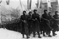 15th SS Division parade through Riga before deployment to Eastern Front, December 1943.