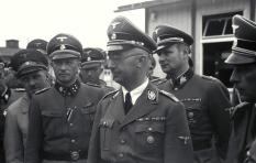 August Eigruber (far left), Franz Ziereis (left), Himmler (front), Karl Wolff (right) and Franz Kutschera (far right) in KZ Mauthausen, April 1941.