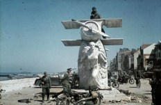 German forces move into Dunkirk hours after the evacuation of the British Expeditionary Force. Curious German officers inspect the memorial to the French aviation pioneer, Louis Bleriot on the sea front at Dunkirk. It is surrounded by German vehicles and the litter of the British evacuation.