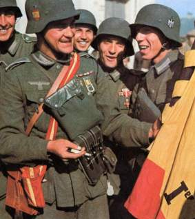 """Spanish """"Division Azul"""" members with their flag."""