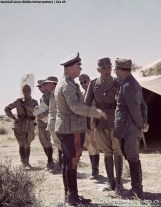 General Erwin Rommel speaking with his Italian allies. In the middle is Sonderführer Dr. Ernst Franz, Rommel's interpreter.