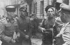 "SS-Gruppenführer Heinz Reinefarth ""Butcher of Wola"" (left, in Cossack headgear) and the Regiment III of Cossacks of Jakub Bondarenko during Warsaw Uprising around Wolska Street. Third Regiment of Cossacks contained a mix of Cossacks from many regions, and Jakub Bondarenko was commanding 5th Regiment of Kuban Cossack Infantry"