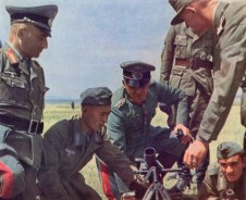 A Tatar helps in firing a German mortar. The general in the center is Generalleutnant Heinz Hellmich, while the general at far left is Generalmajor Hellmuth Nickelmann.