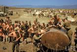 German POWs receive water ration in an Allied-controlled prison camp at El Guettar Valley, Tunisia, 1943.