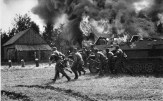 German soldiers move into burning Russian villages.