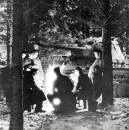 German soldiers around a campfire beside a Panther tank, somewhere in the Ardennes, Belgium.