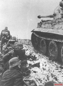 German soldiers take cover beside a Tiger Tank from the 502nd Heavy Tank Battalion near Narva, February 1944.