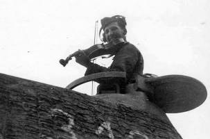 Soldat with a violin in the turret of a tank PzKpfw V Panther.