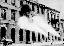 German Brennkommando burn Warsaw. {Taken on Leszno street. From left: building No. 24, 22 & part of 20.}