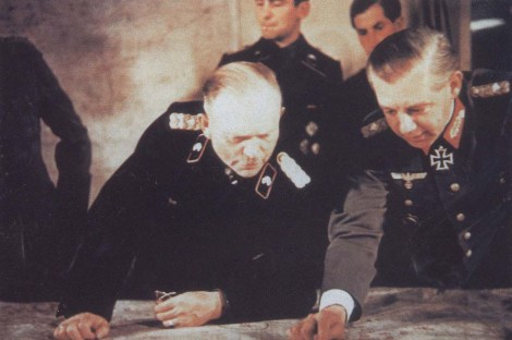 Heinz Guderian and Generalleutnant Walther Wenck (last rank: General der Panzertruppe) discussing strategy over a map. Here we can see Guderian in a rare moment when he wears black panzer uniform!