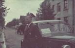 Hans Biebow posing by a car.