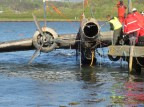 Heinkel He 115 being pulled from the water and being watched by local crowds.