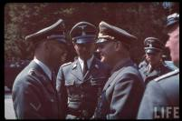 Reichsführer-SS Heinrich Himmler (left) talking with Reichsminister Joachim von Ribbentrop following the French armistice negotiations in Compiègne, northern France, 21 June 1940. In the centre is Himmler's Chief of adjudant SS-Gruppenführer und Generalleutnant der Waffen-SS Karl Wolff.