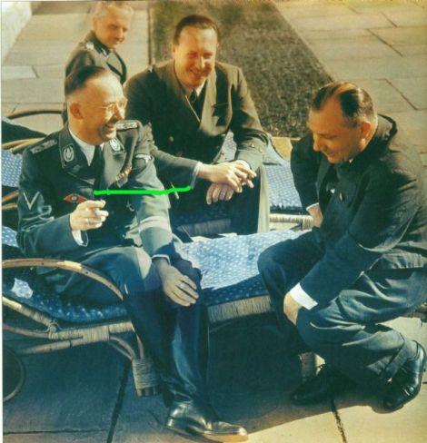 On the terrace of Berghof in the spring of 1943. From left to right: Reichsführer-SS Heinrich Himmler, SS-Brigadeführer Prof.Dr. Hugo Blaschke (behind Himmler), Gesandter Walther Hewel, and Reichsleiter Martin Bormann.
