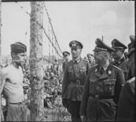 Himmler inspects a prisoner of war camp in Russia, circa 1941.