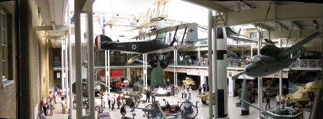 The atrium in August 2009. Ground floor exhibits include: 'Devil' a Mark V tank; 'Ole Bill' an LGOC B-type bus, V-2 and Polaris missiles, 800 mm shell from Schwerer Gustav, and (sand-coloured, extreme right) a Grant tank used by Bernard Montgomery. Suspended aircraft include a Sopwith Camel, Heinkel He 162 and (partially obscured) Supermarine Spitfire number R/6915, which flew in the Battle of Britain and shot down three aircraft.