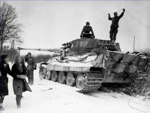 American soldiers inspecting a knocked out King Tiger.