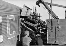 Unloading an engine for a Panther from a Junkers Ju-52.