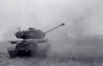 An M26 Pershing fires at German positions across the Rhine.