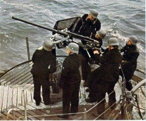 """A color shot of the light naval gun 20mm Oerlikon (2.0cm Flak 28) in action onboard a """"Vorpostenboot"""", a converted fishing cutter."""