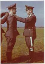 The following (rare) colour photo shows a Luftwaffe night fighter pilot: Manfred Meurer, seen here receiving the Ritterkreuz out of the hands of Gen. Josef Kammhuber in Septtember 1943. This event took place at the airfield of Venlo in Holland.