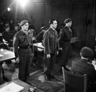 Kurt Meyer stands trial in Aurich, Germany for 5 counts of war crimes in December 1945.