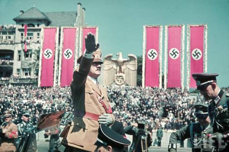 Nazi leader Adolf Hitler saluting leaders & men of the Legion Condor, German Luftwaffe troops which fought alongside Spanish Nationalist troops in the Spanish Civil war, during a rally held in their honor upon their return in Berlin, Germany, 6 June 1939. At far right is Rudolf Schmudt, Führer's adjudant from Heer.