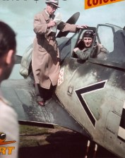 Oberingenieur Rudolf Blaser on the wing of a Focke-Wulf Fw 190 A-2 bearing the tactical marking < + I. This aircraft, Wernummer 20206, was flown by Oberfeldwebel Walter Grünlinger, wingman of the Gruppenkommandeur Hauptmann Josef Priller. Grünlinger had apparently just returned from a combat mission when this photograph was taken, and Blaser is seen explaining some technical aspects of the aircraft.