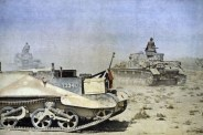 Two Afrikakorps Panzer IV ausf F including turmnummer (turret number) 413 pass a knocked-out captured Carden Lloyd Universal Carrier Mark 1 serial number T33417 armed with a Boys .55 caliber (13.9mm) anti-tank gun.