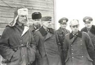 Paulus as POW in centre.