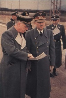 Otto Dietrich behind Adolf Hitler while Reichsminister Joachim von Ribbentroop in the far left.