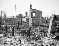 British troops pick through the ruins of Namsos, April 1940.