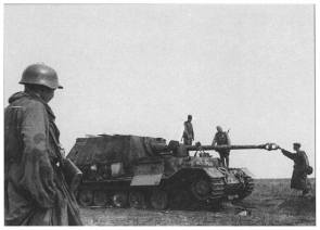 Russian soldiers inspect a captured GermanFerdinand during the Battle of Kursk.