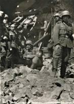 Sani Kompanie posing in the battlefield ruins.