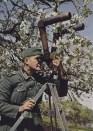 Soldier using scherenfernrohr.
