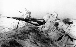 A Soviet machine gunner covers attacking infantry near Tula, in November 1941.