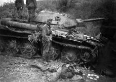 Knocked out T-34 with a soldat over looking a dead Soviet opponent in the Kharkov area.