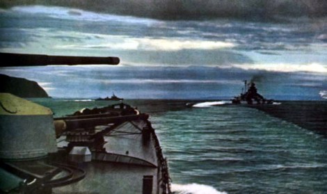 This photo is apparently taken from the heavy cruiser Admiral Hipper and is showing the Tirpitz to the right and to the left of the Tirpitz and a German destroyer can be seen.