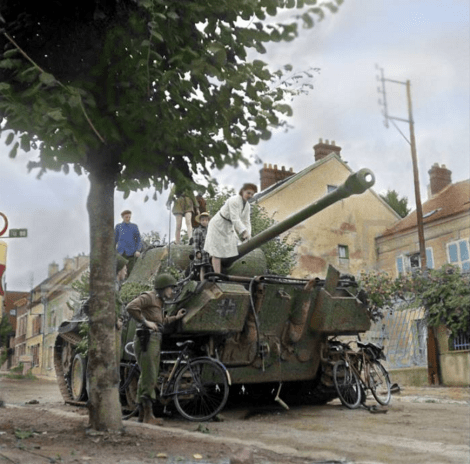 US troops and locals inspect a disabled Panzer V - Panther possibly from the 9th Panzer Division in the Avenue de Soissons, Château-Thierry, France. 28th August 1944.