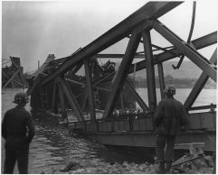 Medics wait for casualties after the collapse of the Ludendorff Bridge into the Rhine on 17 March 1945.