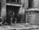 Insurgents from Ruczaj Battalion after fight for Mała PASTa building take pictures at the main entrance at Piusa 19 Street next to a bunker. 24 August 1944.