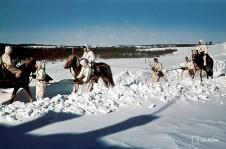 Finnish Hämeen Ratsurykmentti (Hämeen Cavalry Regiment) in a winter patrol through the snow-covered trail in Velikaja Niva, Kareliya (Soviet Union), 15 March 1942.