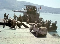 "VW Typ 82 leichter geländegängiger Personenkraftwagen (Kfz. 1) ""Kübelwagen"" in Sicily, Italy, ready to cross the strait of Messina using Siebel ferry (Siebelfähre), 1943."