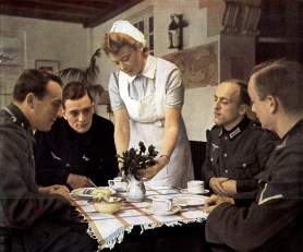 Deutsches Rotes Kreuz (DRK) or German Red Cross nurses basic uniform worn by the DRK helferin/helferinen (helpers) during wartime consisted of medium grey pleated-front blouse or a blue-grey pinstriped blouse and skirt with detachable white collar as shown in the following photo.