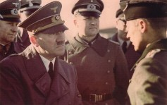 Adolf Hitler meets with a soldier. Standing in the back was Alfred Jodl (left) and Gerhard Engel.