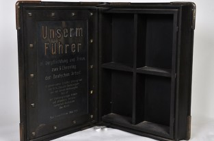 """Inside This is the cabinet's inside. The inscription: """"To our leader, with duty and loyalty on the 6th day honoring German work."""""""