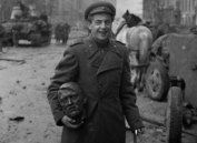 Soviet soldier with a bust of Hitler after the Battle of Berlin.
